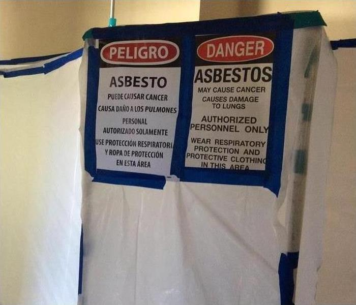 Containment for asbestos testing.